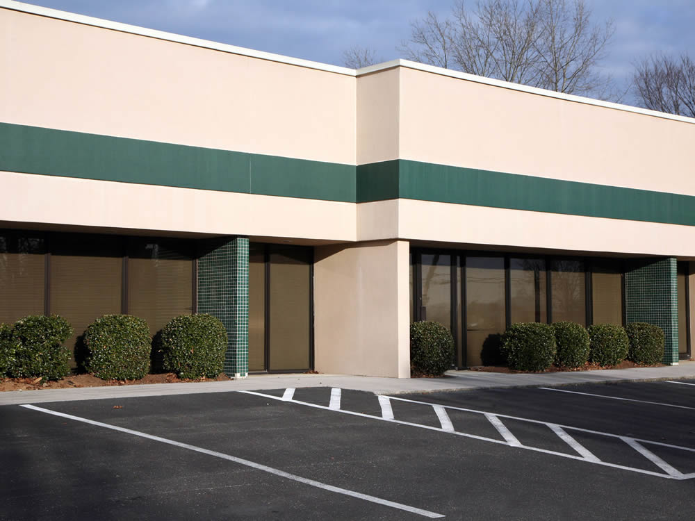 Commercial Exterior Spray Painting By Surface Painters